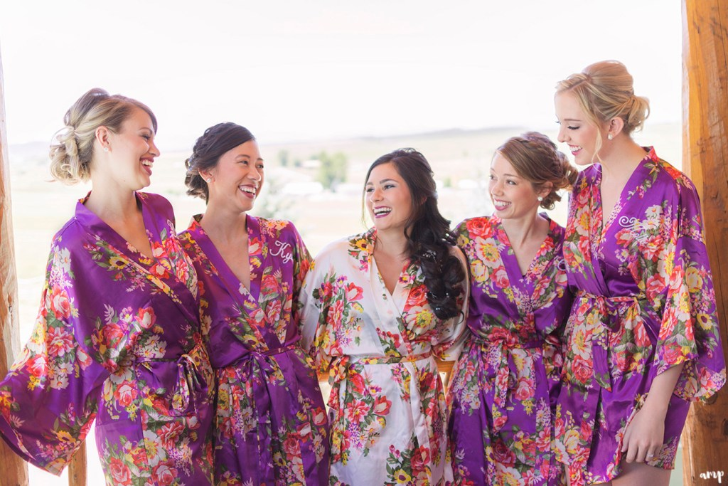 Bridesmaids in matching robes getting ready