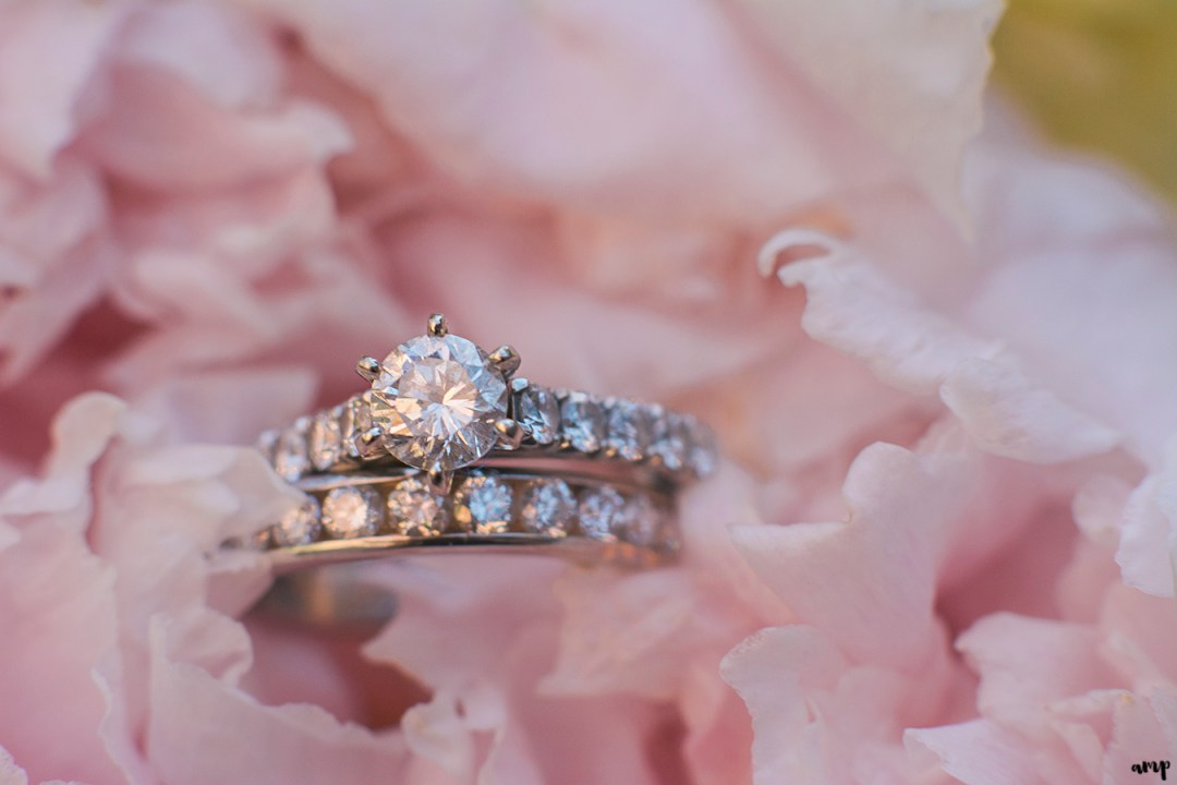 Wedding rings in a peony