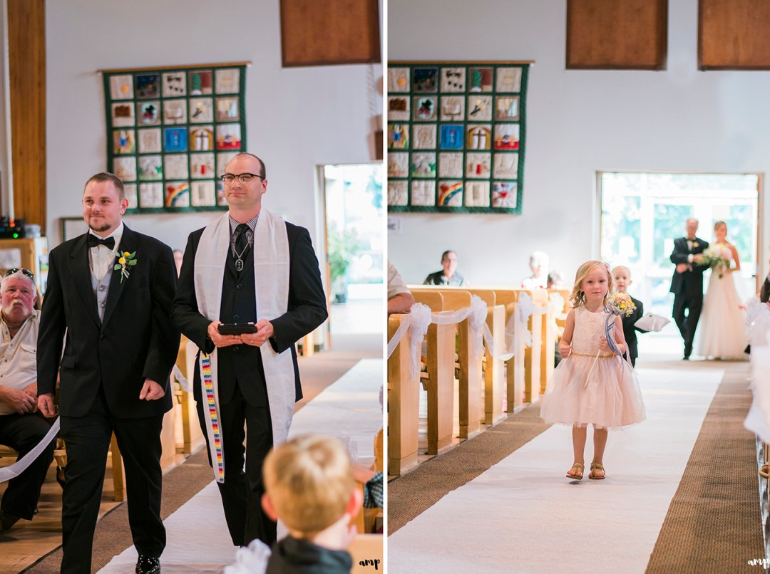 Groom and flower girl walk down the aisle