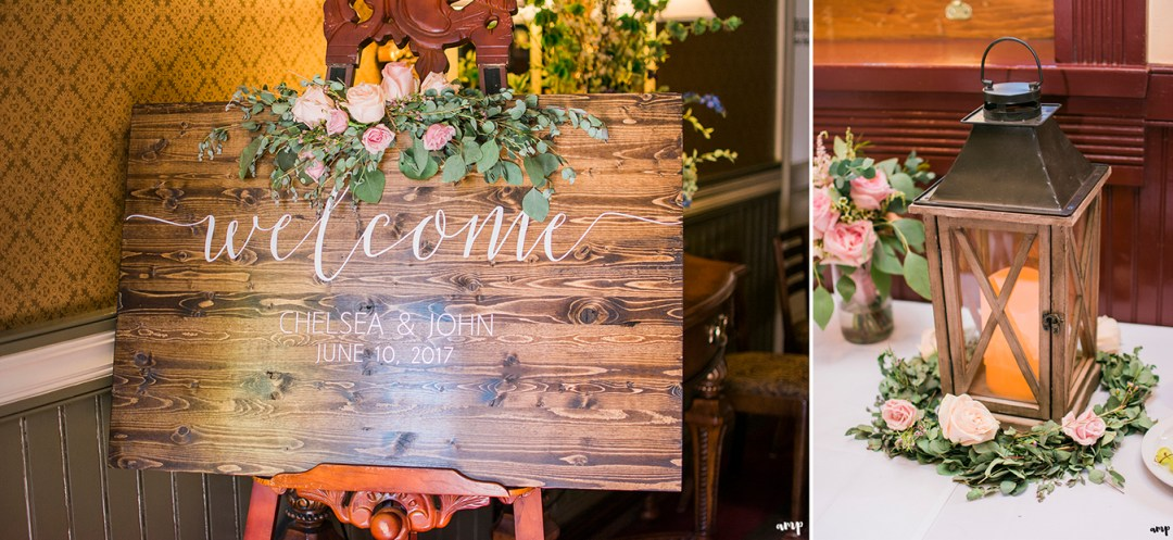 Wooden welcome sign and large lantern decor