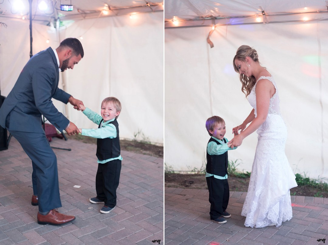 Bride and groom dance with a young guest