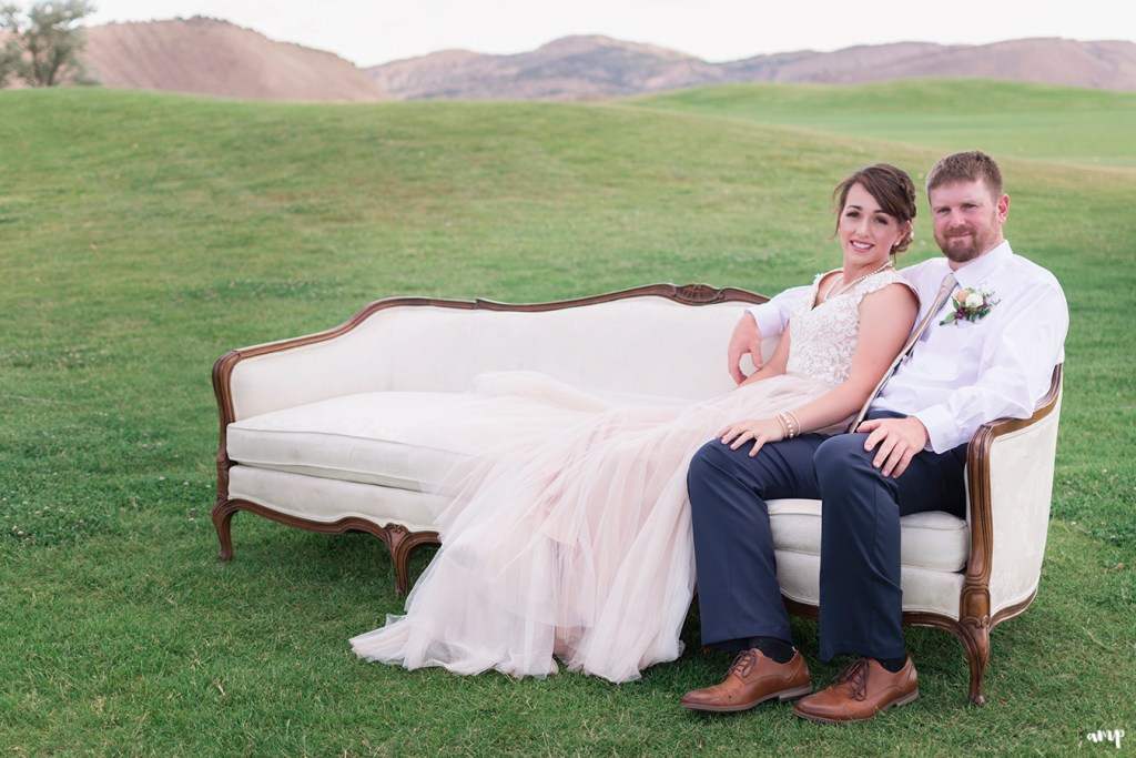 bride and groom on vintage sofa