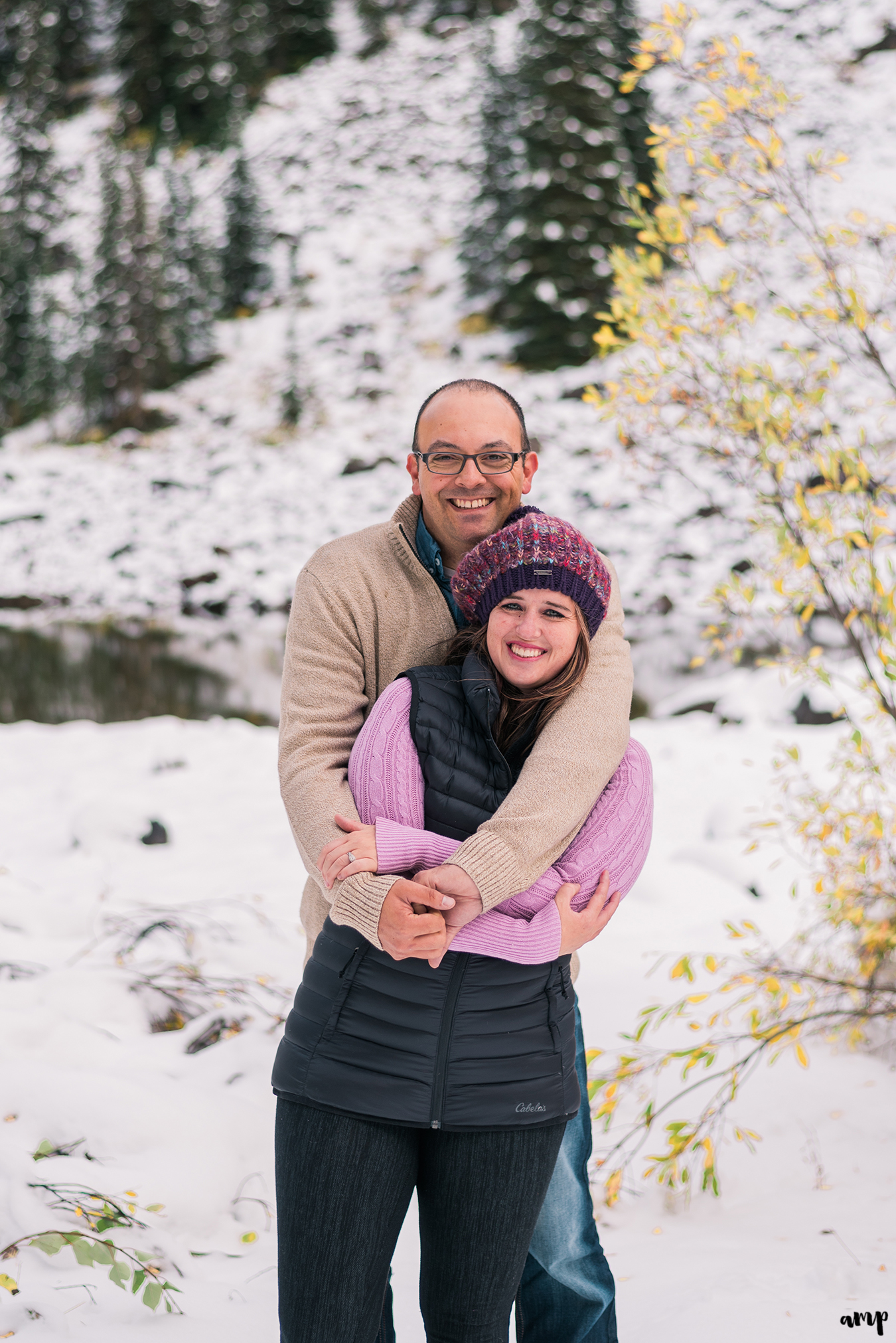 Couple snuggling in the snow on the Grand Mesa
