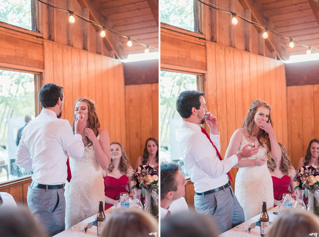 Bride and groom split a donut at their wedding reception at the mountain wedding garden in crested butte