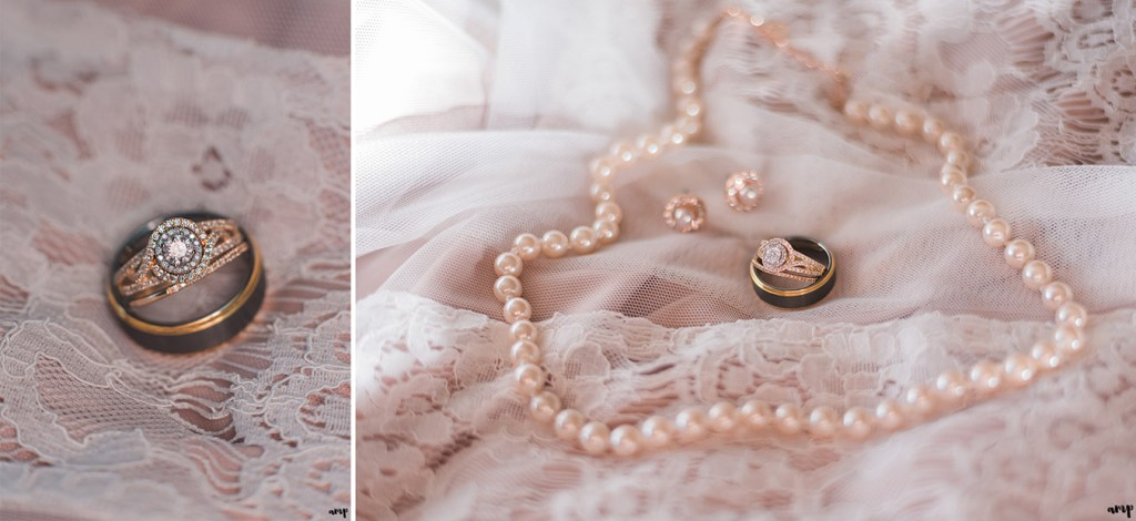 Gold wedding rings and pearls on a blush lace dress