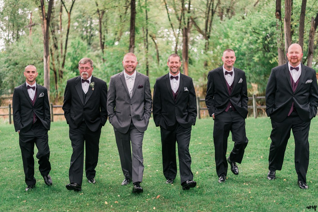 Groomsmen walking toward the camera