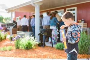 Kid blowing bubbles at a Palisade Wedding