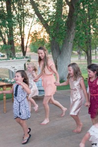 Kids run around the wedding dance floor at a Rangely Colorado Wedding