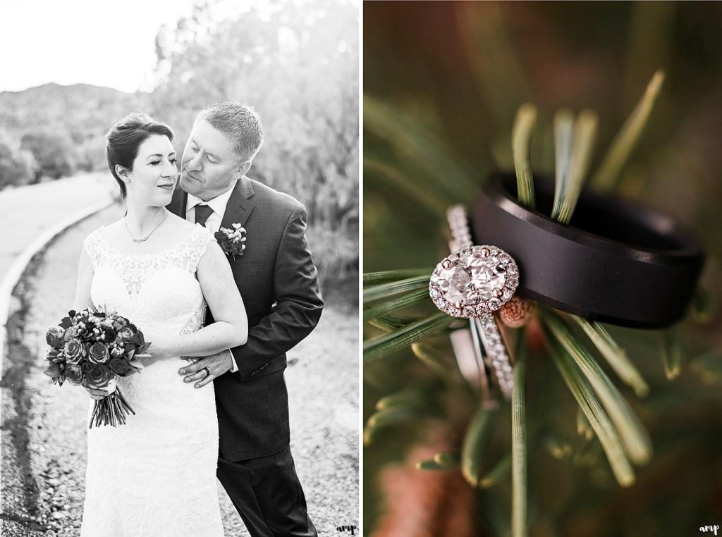 Wedding rings posed on juniper tree
