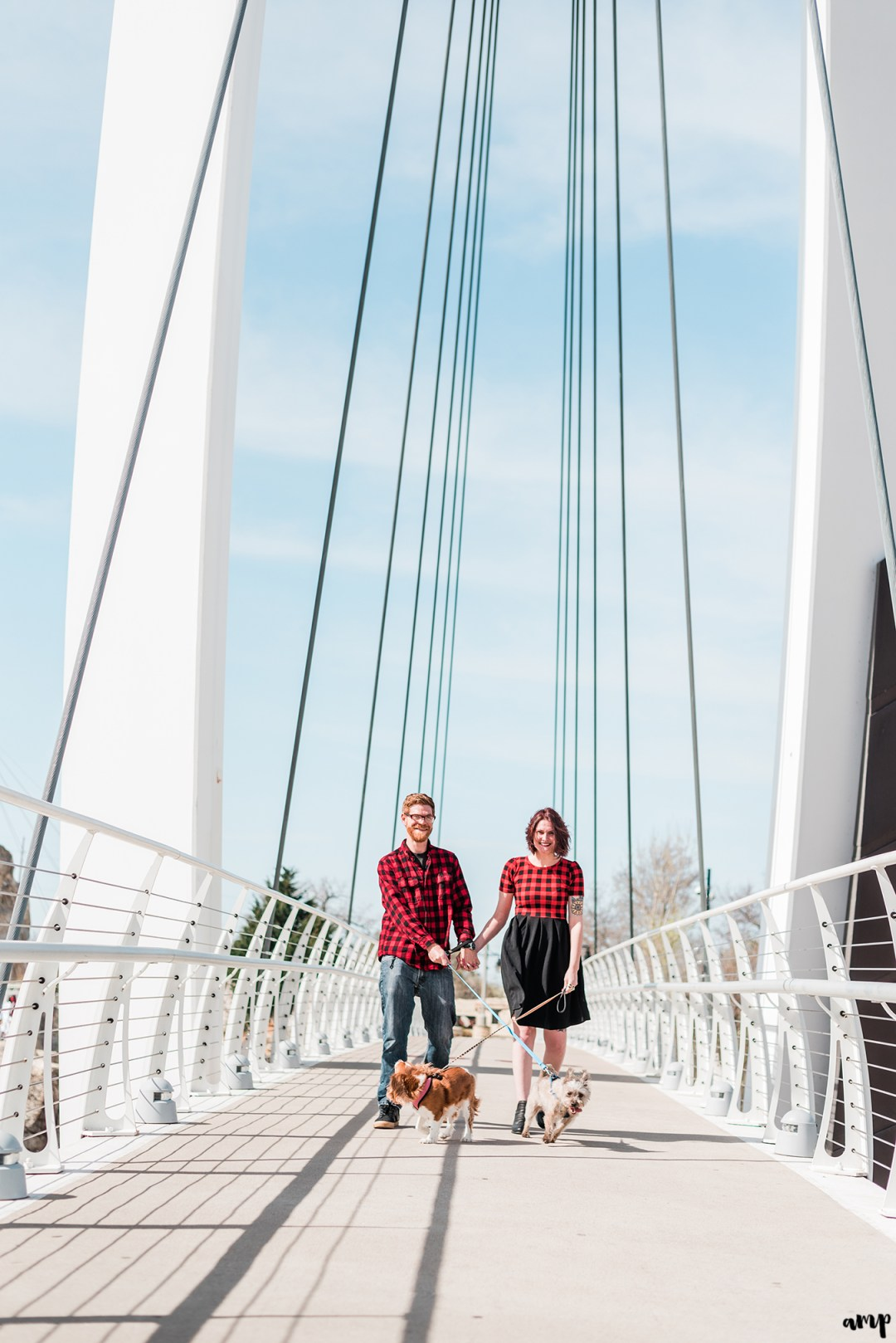 Ben and Courtnee walking their dogs along the Keeper of the Plains bridge
