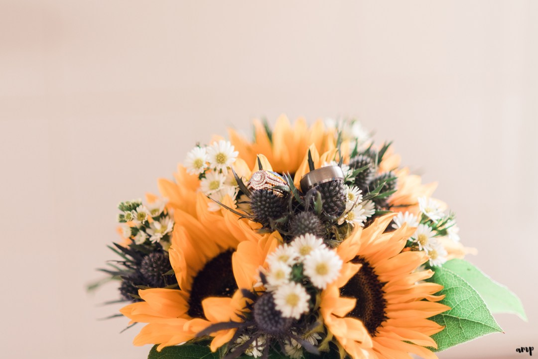 Courtnee's bouquet with sunflowers and blue thistle