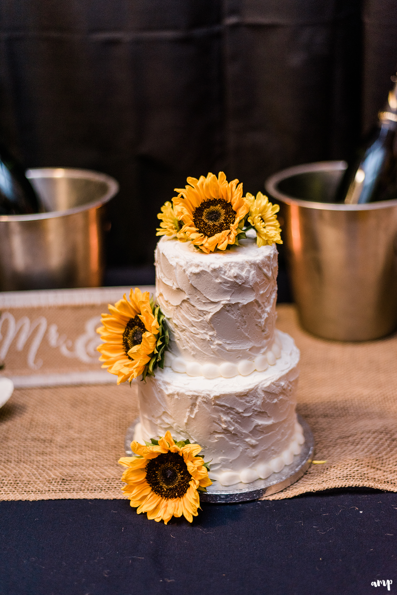 White frosted cake with sunflowers adorning it