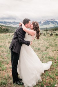 Travis dips Erica for a kiss in front of chimney rock | Ridgway Colorado