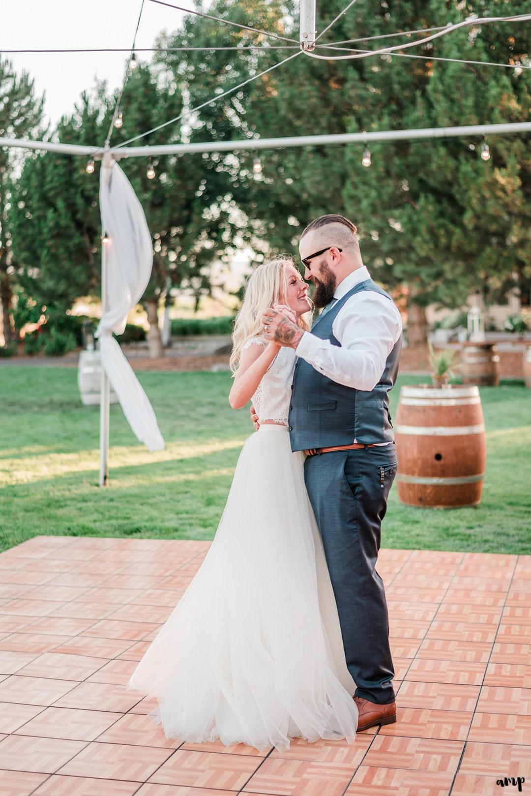 Beth and Dustin's first dance | Grand Junction Backyard Wedding | amanda.matilda.photography