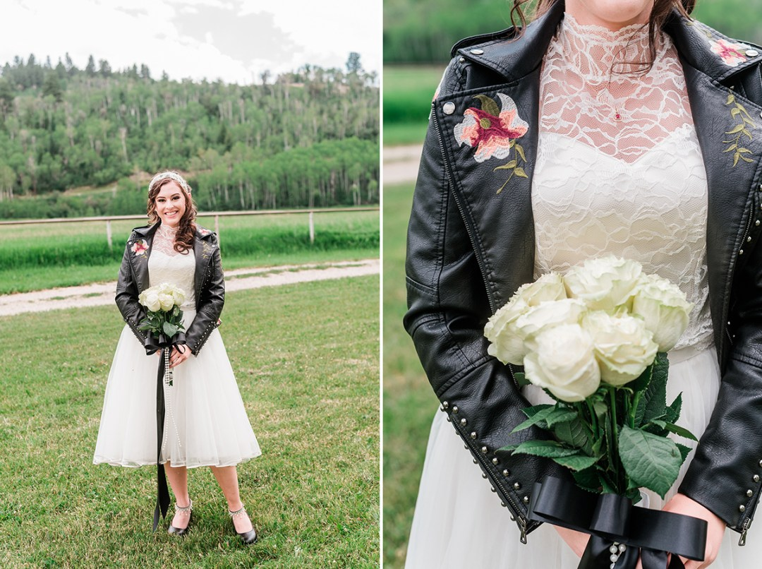 Bride wearing a black leather jacket with her two piece wedding dress