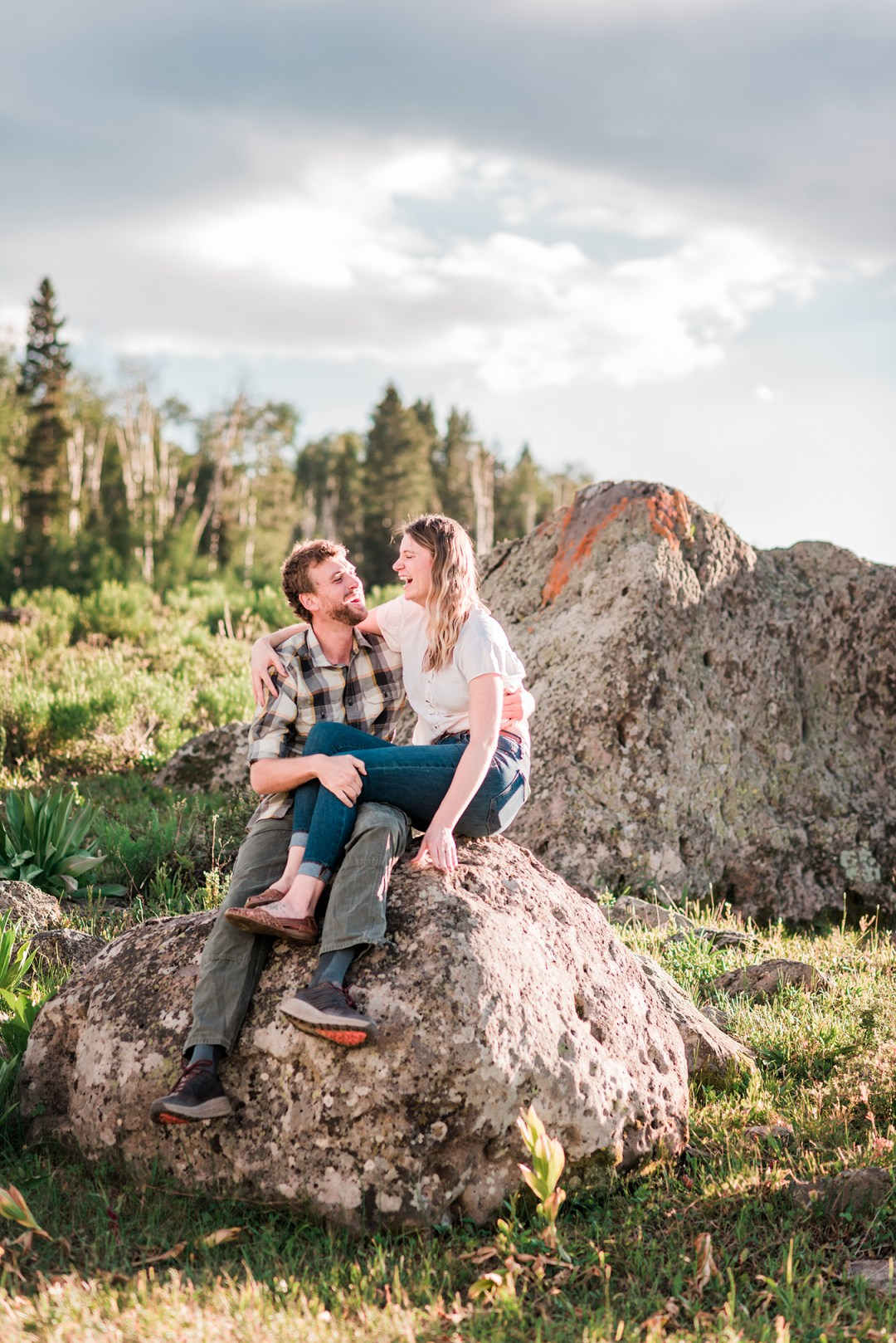Annie & Taylor sitting on a boulder for their Glenwood Springs Engagement Photos
