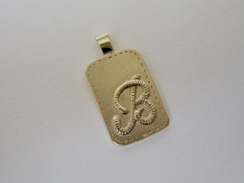 Gold pendant with a 'B'