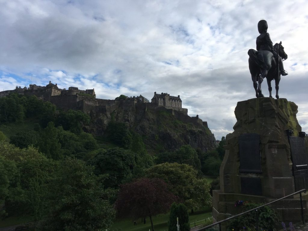 Edinburgh castle and statue in Princes Street Gardens