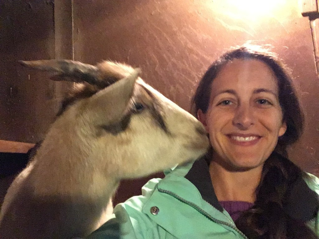 Amanda Walkins and Pan the goat cuddling