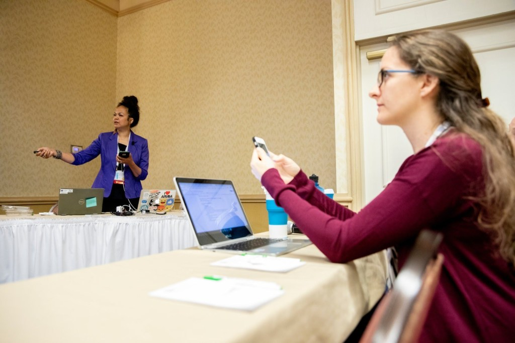 Writer Amanda Walkins taking notes and photos at WITS travel conference