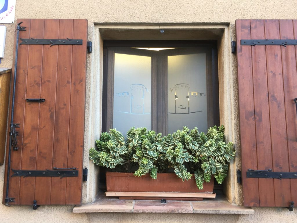 traditional wooden shutters on a home in southern France