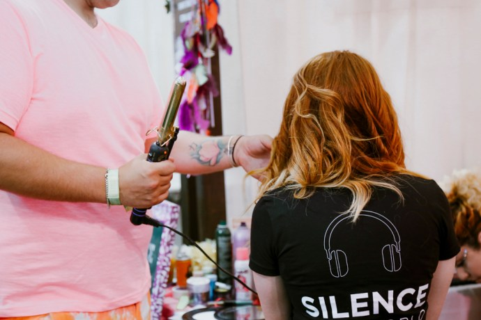 BottleRock Napa Valley Photography of C-Love Team Hair Stylist Curling Hair by Amarie Design Co.