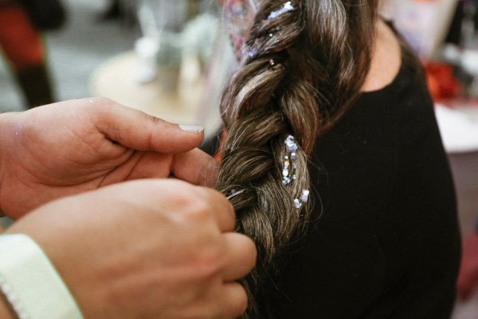 BottleRock Napa Valley Photography of C-Love Team Hair Stylist Braiding Hair with Glitter by Amarie Design Co.