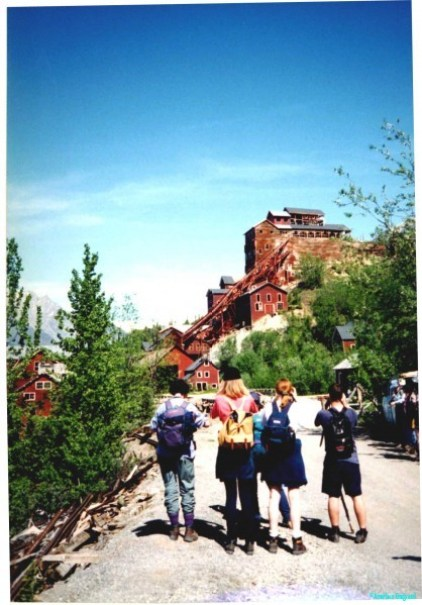 Tall wooden buildings, painted red ochre stretch up the hillside, a relic of the days long ago when copper prices meant it was viable. A group of hikers stand on the dirt road admiring this industrial archaeology. There are bears on the trail leading here.