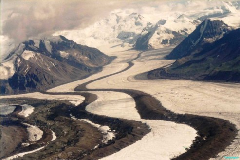 Streams of ice coming from several valleys snake through the landscape, the darker lines are the lateral moraines which on merging with other glaciers become medial moraines