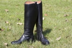 Knee length black leather lace-up riding bootss