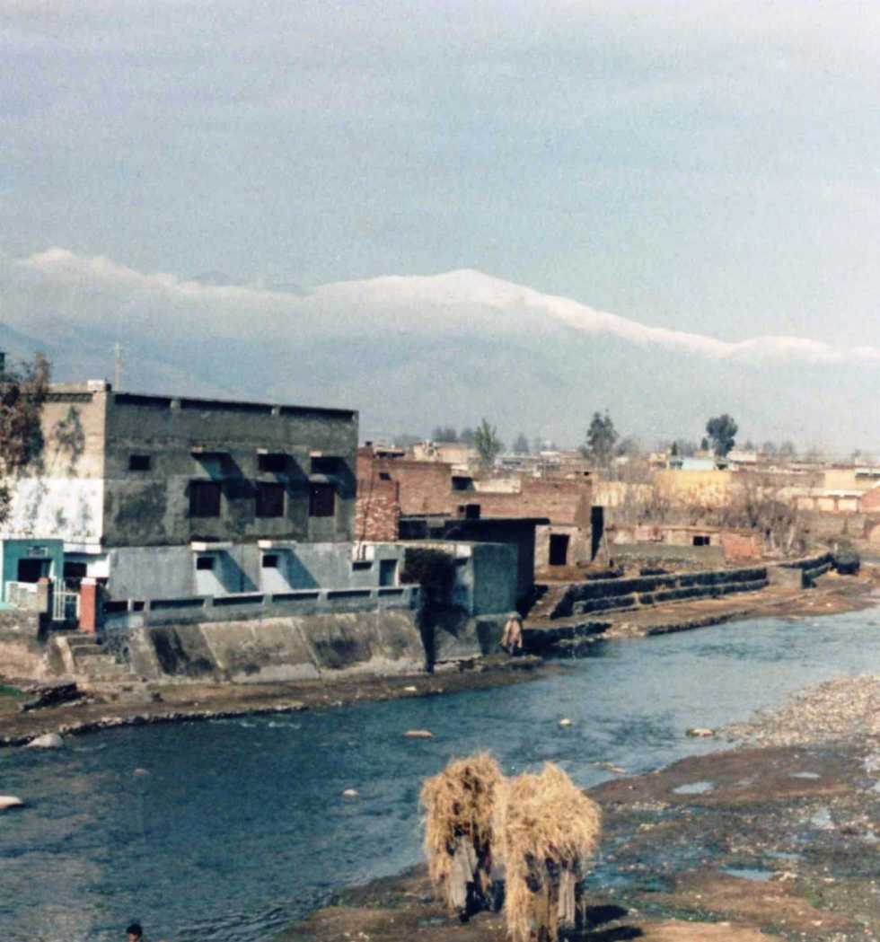 View of the Swat River in Mingora, Swat with mobile haystacks !