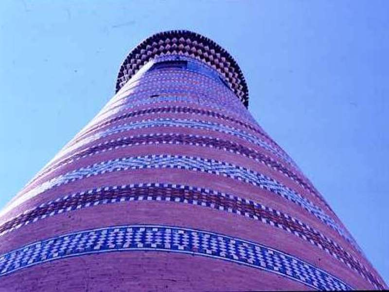 Minaret, Bokhara, with bands of geometric tile patterns adorning the tower