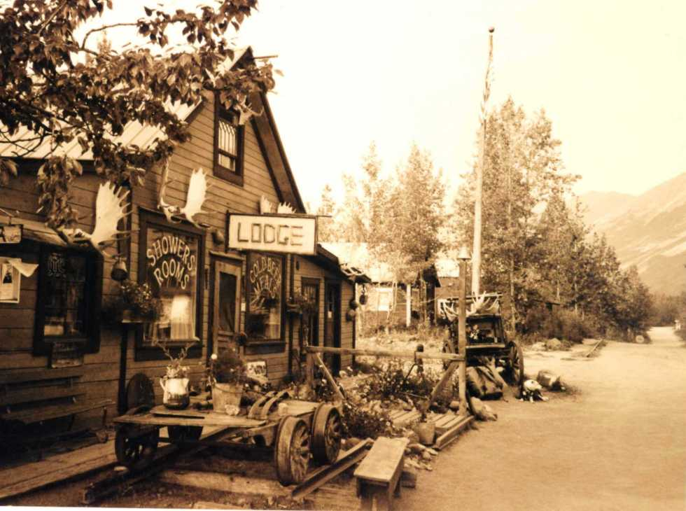Old sepia style image of timber lodge at the end of the road in Alaska
