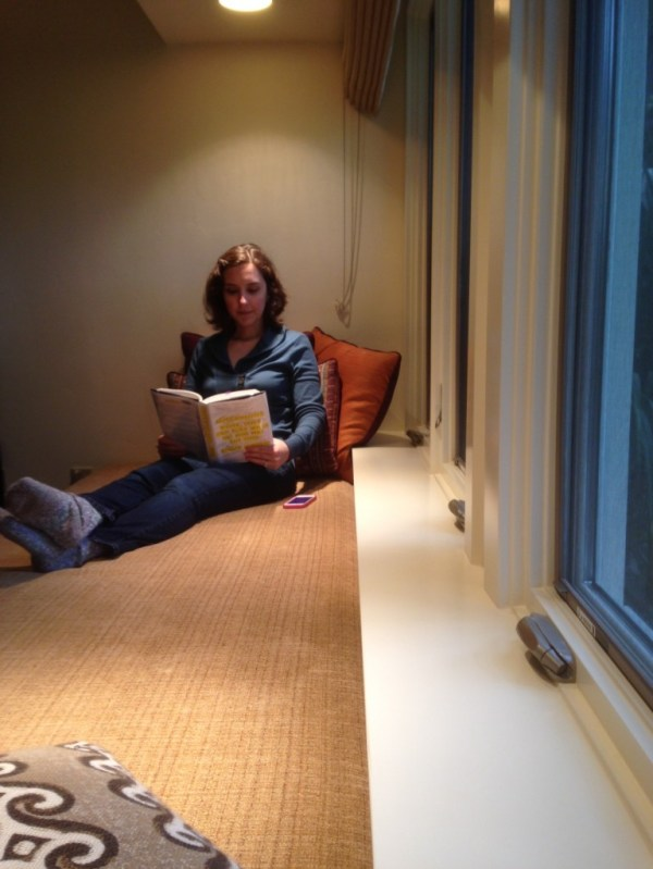 Reading in the window seat