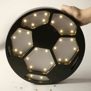 With a charming design, the Soccer Ball Wooden Night Light provides a reassuring glow for your little one, making it perfect for a nursery or kids room nightlight, or an interesting addition to any other space.