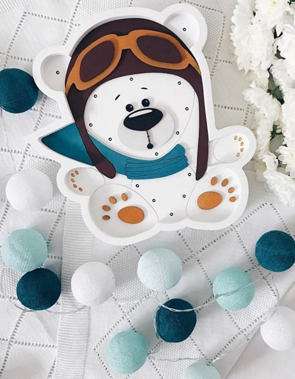 Perfect for setting a calm moon in your kid's bedroom, the White Pilot Bear Decorative Night Light gives a soft glow when turned on.