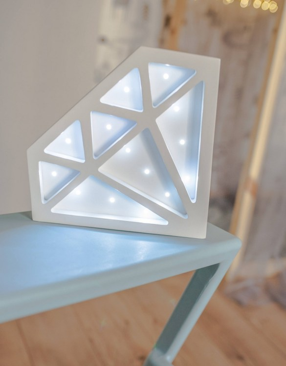 Perfect for setting a calm moon in your kid's bedroom, the Diamond Decorative Night Light gives a soft glow when turned on.