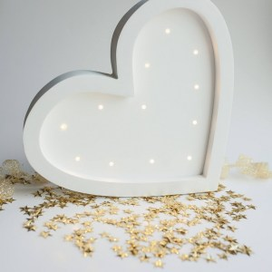 Perfect for setting a calm moon in your kid's bedroom, the Heart Decorative Night Light gives a soft glow when turned on.