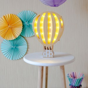 Perfect for setting a calm moon in your kid's bedroom, the Hot Air Balloon Decorative Night Light gives a soft glow when turned on.