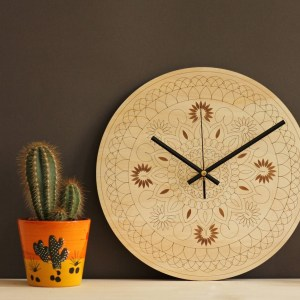 With a sophisticated and functional look, the Mandala Wooden Wall Clock will add an element of starry spirit to any room.