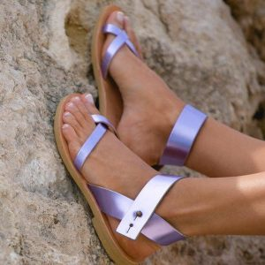 Just what every summer wardrobe needs, the Penelope Metallic Purple Greek Leather Sandal is every woman's dream pair, super comfy and elegant, and easily combined with any outfit.