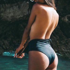 Express yourself differently each day in reversible styles with the Black Pine One-Piece Swimsuit. Take the plunge in our sexy and chic v-neck one piece. Featuring a deep plunge neckline, supportive cross back strap, and booty coverage in back. The Mustang wonder features an adjustable knotted waist belt.