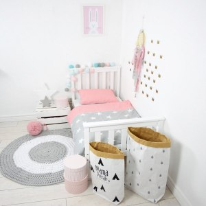 Add fun and style to your little one's bedroom with the Coral Pink and Grey Baby Crib Bedding Set. This charming children's bedding set is a great choice for a contemporary themed nursery or children's room.