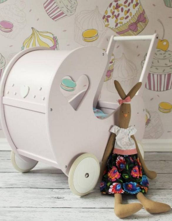 Perfect for taking dolly or teddy for a walk, the Handmade Wooden Doll Pram Heart Beige-Pink will parkle your child's imagination and create hours and hours of play! This gorgeous wooden pram is perfect for little girls to take their favourite dolls for a ride, it has rubber wheels and is suited to younger children.