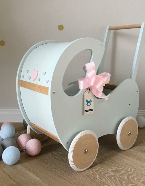 Perfect for taking dolly or teddy for a walk, the Handmade Wooden Doll Pram Mint & Natural Wood will parkle your child's imagination and create hours and hours of play! This gorgeous wooden pram is perfect for little girls to take their favourite dolls for a ride, it has rubber wheels and is suited to younger children.