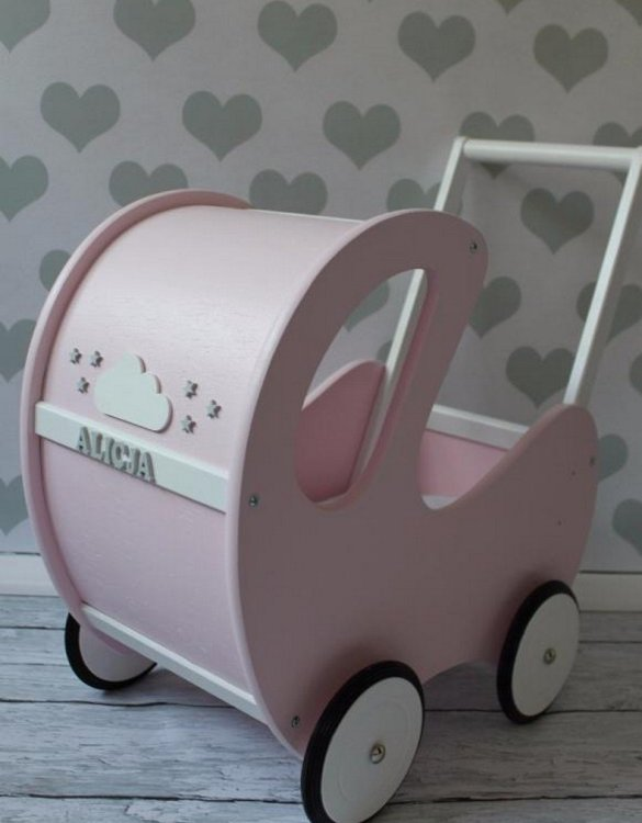 Perfect for taking dolly or teddy for a walk, the Handmade Wooden Doll Pram Pink will parkle your child's imagination and create hours and hours of play! This gorgeous wooden pram is perfect for little girls to take their favourite dolls for a ride, it has rubber wheels and is suited to younger children.