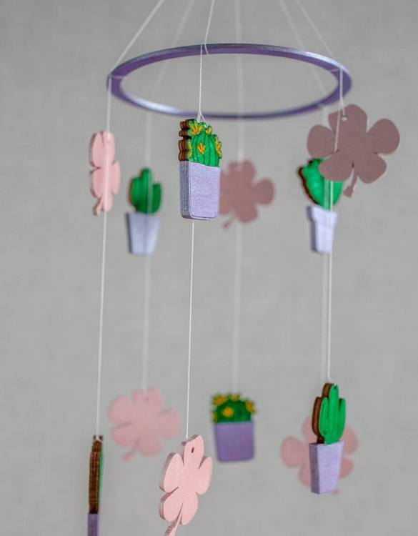 A perfect addition to any baby's room, the Cactus Wooden Baby Mobile enchants children's eyes and escorts them into the land of dreams. This enchanting neutral gender baby mobile is sure to delight any child and will make the cutest addition to a woodland themed nursery decor.