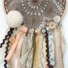 Perfect for a nursery or child's bedroom, the Box of Chocolates Handmade Dream Catcher looks great as a new baby gift or to hang in the baby's nursery. Dream catchers are totems that represent good energy, and neutralize negative energy at home.