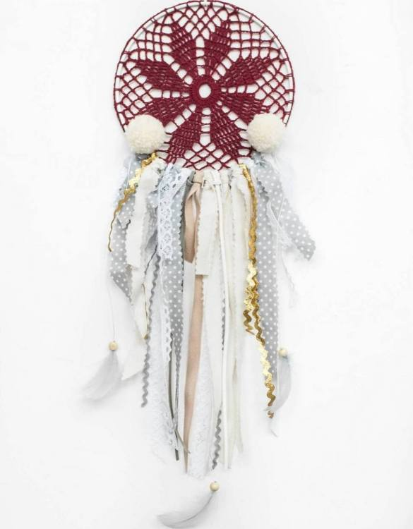 Perfect for a nursery or child's bedroom, the Maroon Handmade Dream Catcher looks great as a new baby gift or to hang in the baby's nursery. Dream catchers are totems that represent good energy, and neutralize negative energy at home.