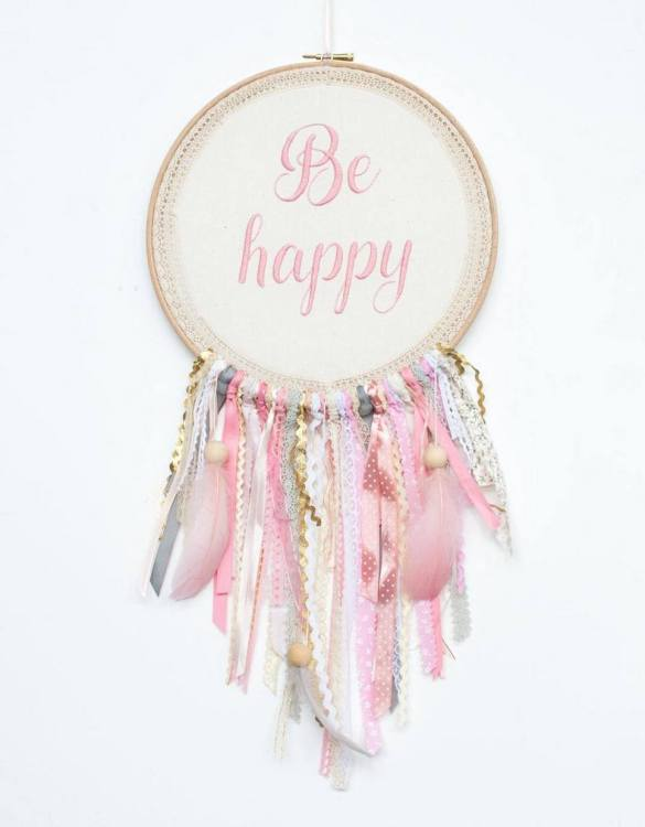 Perfect for a nursery or child's bedroom, the Pink Be Happy Handmade Dream Catcher looks great as a new baby gift or to hang in the baby's nursery. Dream catchers are totems that represent good energy, and neutralize negative energy at home.